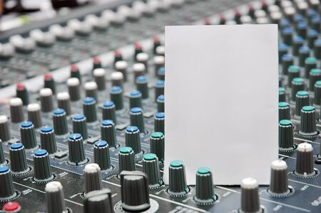 audio mixer: Paper blank with Sound mixer Stock Photo