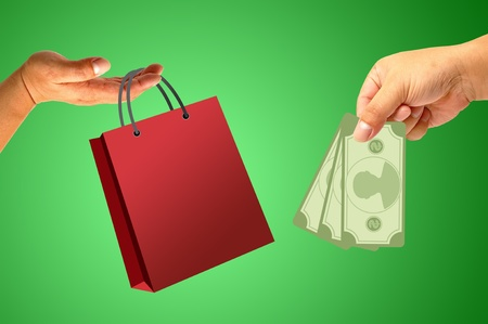 Shopping bag in hand with money