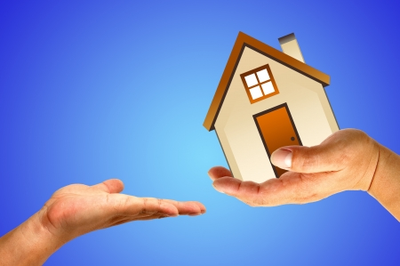 Hand and house