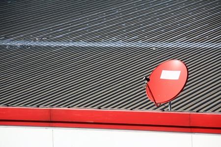 parabolic: Satellite dish on the roof  Stock Photo