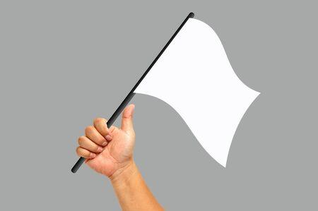 Hand holding white flag isolated on white background photo