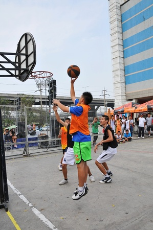 Pathumthani, Thailand January 15. Student basketball tournament. Job title-FUTURE PARK SHOOTIT STREET ON 3. At shopping center future park, Pathumthani, Thailand. Stock Photo - 11952103