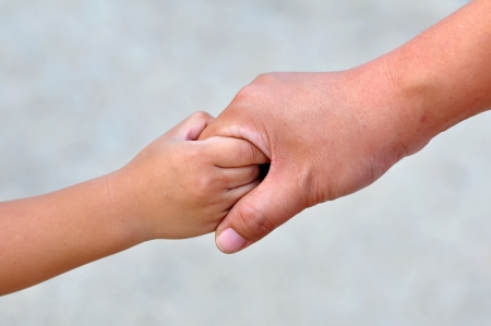 Adult and childs hands holding Stock Photo