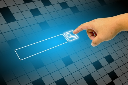 Hand clicking internet search page on computer touch screen Stock Photo
