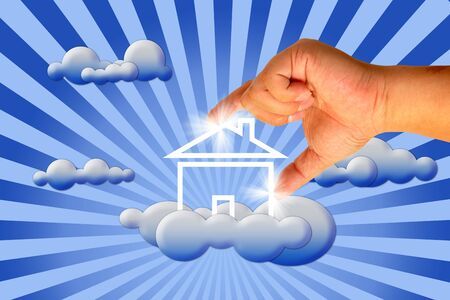 House in clouds with hand photo