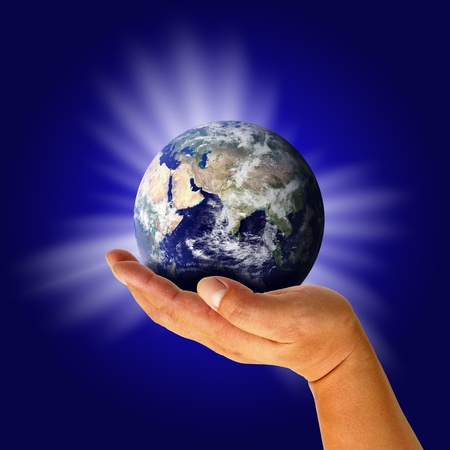 Male hand holding the Earth Stock Photo - 12971299