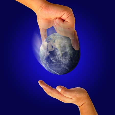 Male hand holding the Earth  photo