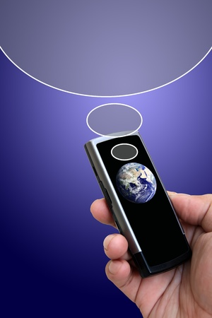 Hand holding mobile phone with earth globe photo