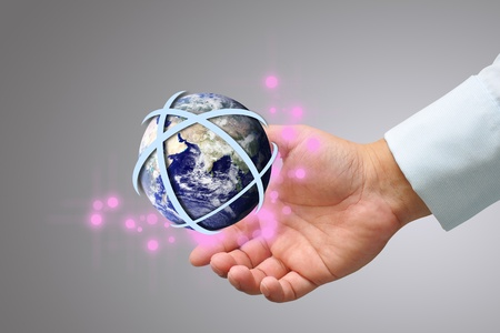 hand holding the earth globe with gold arrow photo