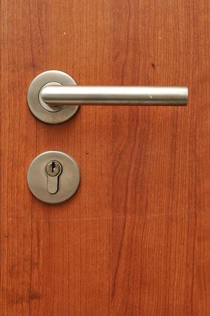 Modren style door handle on natural wooden door