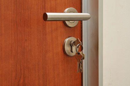 Modren style door handle on natural wooden door photo