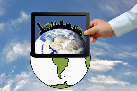 Hand holding tablet PC with city on earth globe Stock Photo - 13533202