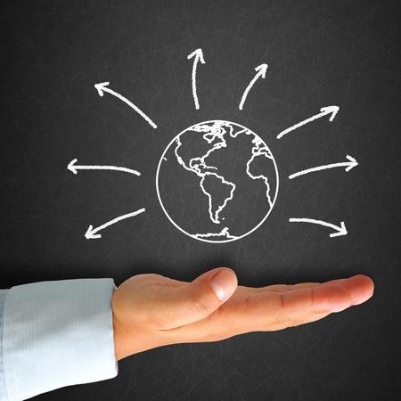 World map in blackboard with hand Standard-Bild