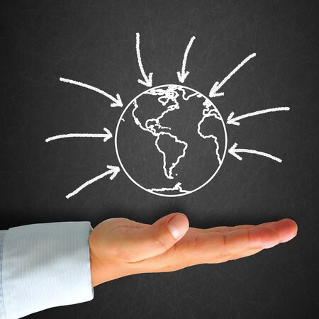 World map in blackboard with hand Stock Photo