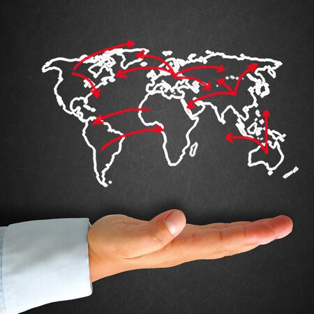 World map in blackboard with hand photo