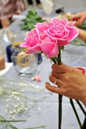Hand Arranging Flower At school