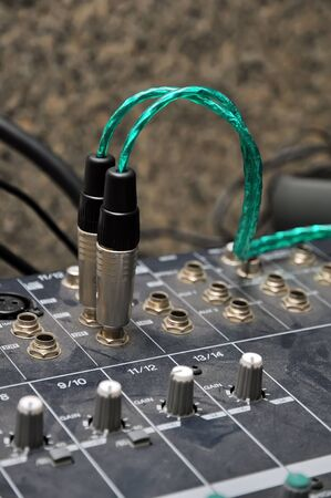 audio jack and cable with dirty sound mixer photo