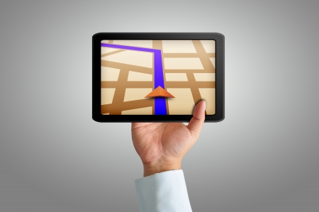 car navigation: Male hand holding a touchpad gps Stock Photo