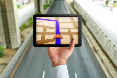 Male hand holding a touchpad gps Standard-Bild