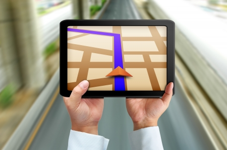 road position: Male hand holding a touchpad gps Stock Photo
