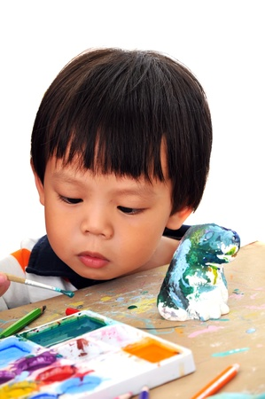 Child 2 years painting in preschool photo