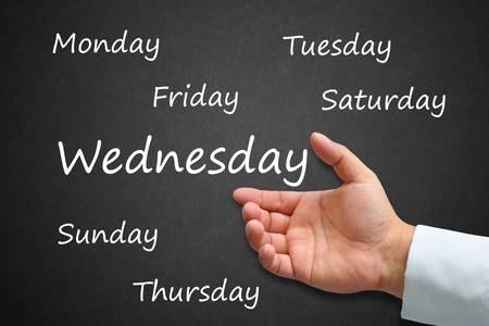 Wednesday Written on Blackboard with hand Stock Photo - 14911983