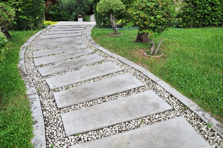 Stone walkway on a grassy in the garden