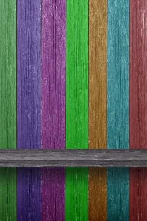 Empty wood shelf on Multicolored wood wall photo