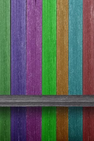 Empty wood shelf on Multicolored wood wall Stock Photo - 15238975