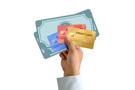 Hand holding credit card with money isolated on white background photo