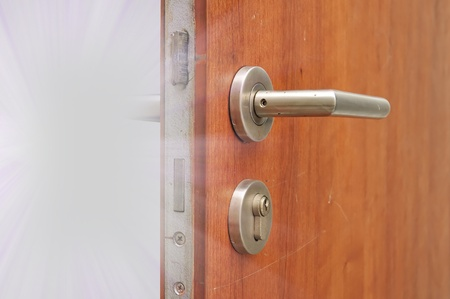 Modren style door handle on natural wooden door with white light photo