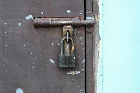 Locked door of iron on the wooden door photo