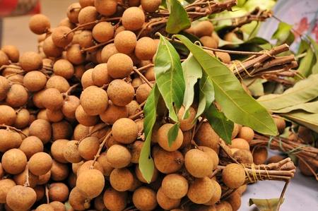 Longans of sweet taste,  Tropical fruit in market, photo