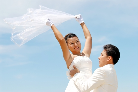 Couple on the beach in wedding dress. Bride and Groom photo
