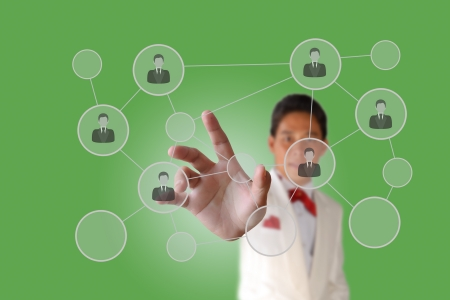 Businessman pushing people Social Network on the green data background photo