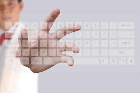 Businessman hand pushing button on a touch screen computer keyboard photo