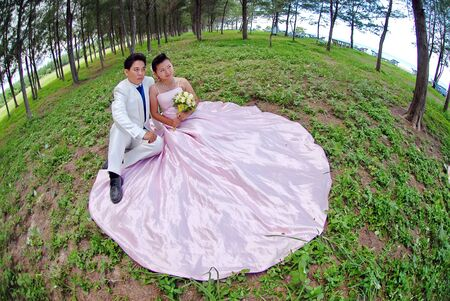 A portrait of the beautiful Couple in wedding dress photo
