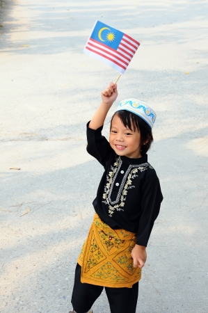 Young boy holding a flag of Malaysia