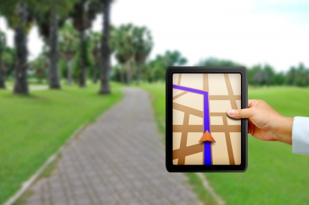 global positioning system: Male hand holding a touchpad gps Stock Photo