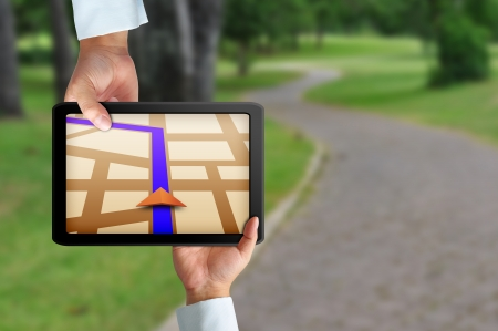 Male hand holding a touchpad gps Stock Photo - 18452289