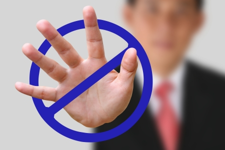 Portrait of Business man making stop gesture on white background