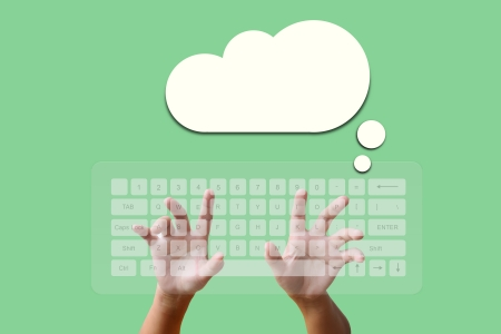 Hand on Keyboard with Cloud on the green background photo