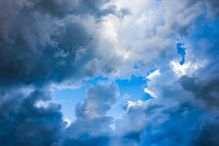 Coming of storm cloud on clear blue sky Stock Photo