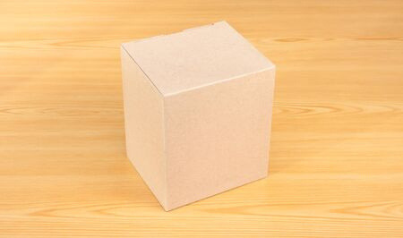 goffer: Blank Brown Paper Box  mock up on wood table Stock Photo