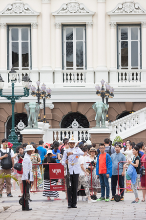 military watch: Bangkok, Thailand - July 17, 2015: Tourists watch military making salute gesture at Grand palace. Editorial