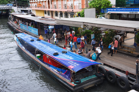 Bangkok, Thailand - June 18, 2015: Passengers getting off boat at Pratunam Pier, The Khlong Saen Saep boat service carries about 60,000 passengers per day in citys traffic-congested commercial districts
