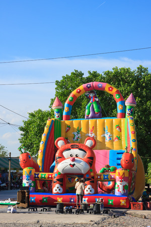 Samut Prakan, Thailand - May 31, 2015: Portable air slide blower theme park sets up at countryside market fair for child daycare while parent shopping