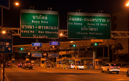shortcut: Bangkok, Thailand - June 21, 2015: The toll payment gate for expressway Yommarat station at night, Traveling by expressway is a shortcut to avoid traffic jam on ground