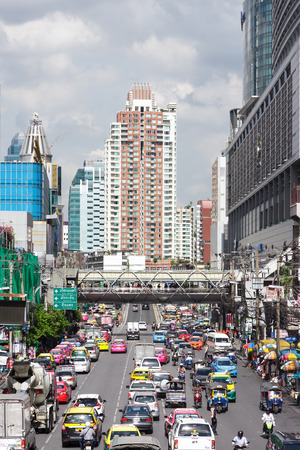 rd: Bangkok, Thailand - June 19, 2015: Picture of vehicles traffic on Phetchaburi Rd and high rise shopping building at Pratunam commercial districts