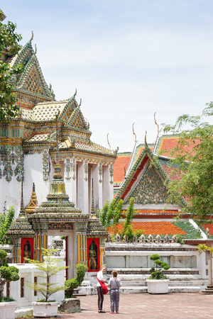 top 7: Bangkok, Thailand - June 7, 2015: Foreign tourists visit Wat Pho-- is the top tourist attractions in Bangkok